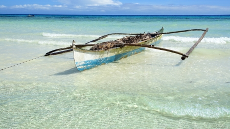 Boat on a tropical beach, Bohol Island, Philippines photo