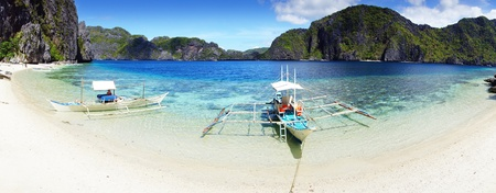 Boats on a beach  El Nido, Philippines photo