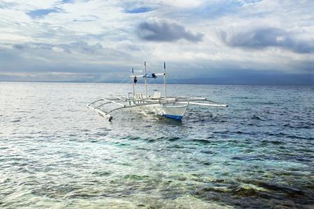 apo: Picturesque seascape with bangka  Apo island, Philippines