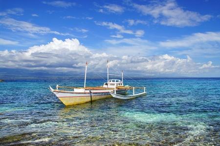 apo: Picturesque seascape with boat. Apo island, Philippines