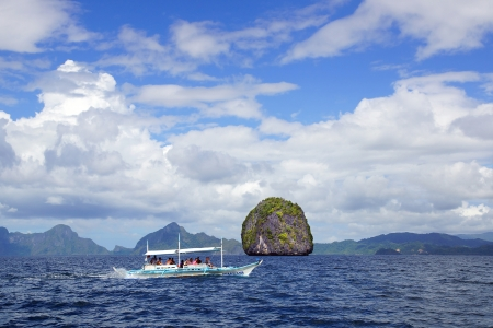 apo: APO ISLAND  - FEBRUARY 08: Tourists on the boat travel between the Islands. El Nido is one of the top tourist destinations in the world on Febuary 08, 2013 in Apo island, Philippines