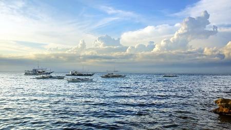 apo: Picturesque seascape with boats. Apo island, Philippines