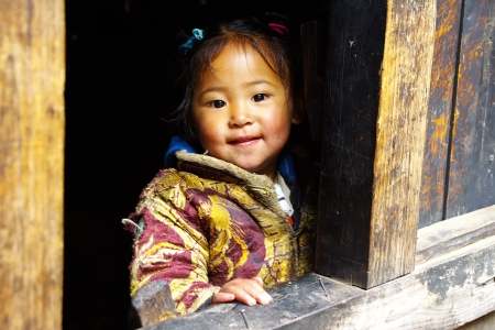 LUKLA, NEPAL -November 16, 2008: Unidentified sherpa girl in Lukla, Everest Region, Nepal. Sherpa are an ethnic group from Nepal, highly regarded as elite mountaineers.