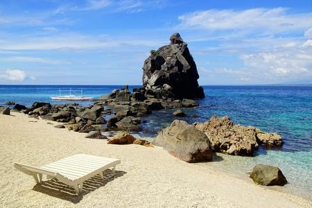apo: Seascape with chaise lounge. Apo island, Philippines Stock Photo
