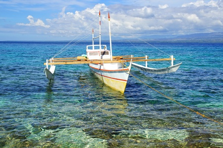 Picturesque seascape with bangka. Apo Island, Philippines, photo