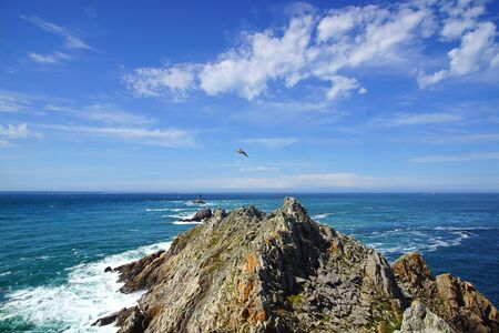 Lighthouse on Cape Sizun, Pointe du Raz. Brittany, France photo