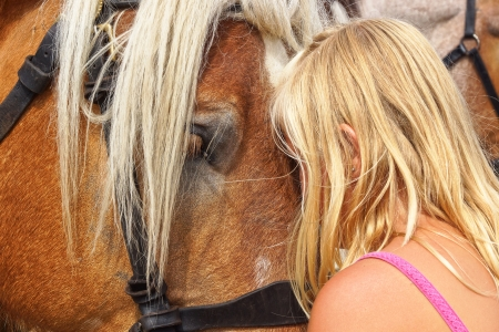 Teenage girl with her horse. Westkapelle, Holland photo