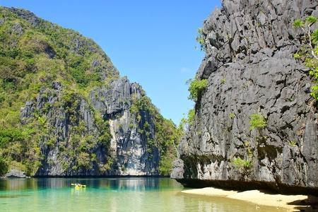 philippine adult: Tourists on a kayak on the lagoon. El Nido, Philippines Stock Photo
