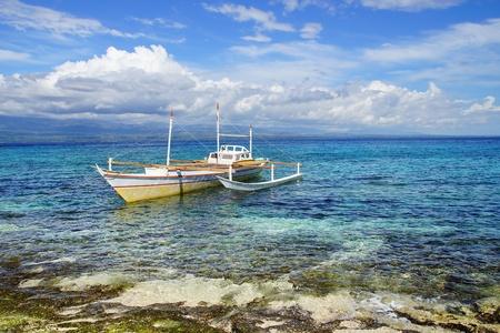 apo: Picturesque seascape with bangka. Apo Island, Philippines,