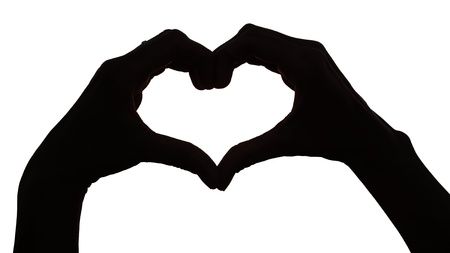 Silhouette hand in heart shape on white background photo
