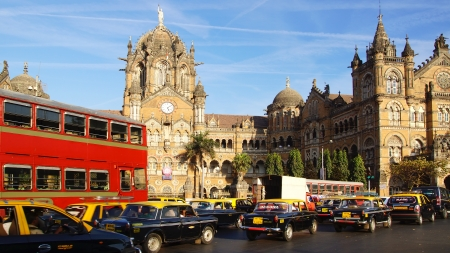 marathi: MUMBAI,INDIA - FEBRUARY13:Black-ye llow cabs in front of the Victoria Terminus. Designed by Frederick William Stevens. Victoria Terminus, is a UNESCO World Heritage Site on Febuary 13, 2012 in Mumbai