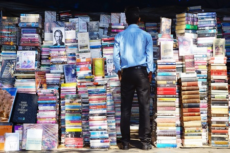 street wise: MUMBAI, INDIA - FEBRUARY 13: Piles of books on the booksellers-street on Febuary 13, 2012 in Mumbai. Here can buy books, originals and counterfeits, at 20-60% of the listed publishers price;
