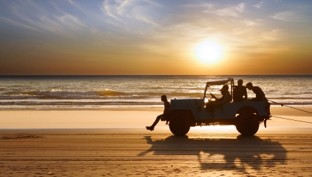 Silhouette of a car during Sunset on the Indian Ocean.