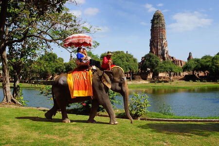 AYUTTHAYA, THAILAND - DECEMBER 17  Tourists on an elefant ride around the Park on December 17, 2013 in Ajutthaja,Thailand  The city of Ayutthaya was founded in 1350 and was the capital of the country