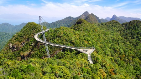 langkawi island: Curved pedestrian cable-stayed bridge.  Langkawi, Malaysia. Stock Photo