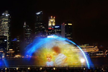 searchlights: SINGAPORE - FEBRUARY 05, 2014  Light and Water Show  Wonder Full  at Marina Bay Sands  The show is created using lasers, searchlights, video projectors   Editorial