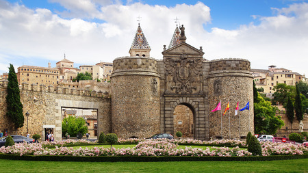 main gate: TOLEDO, SPAIN - JUNE 09, 2014: Alfonso VI Gate. The Old Bisagra Gate-Alfonso VI Gate, is one of Toledo?s best-known monuments. Built in the 10th century under Muslim domination, for a long time it was the main entrance gate to the city of Toledo.