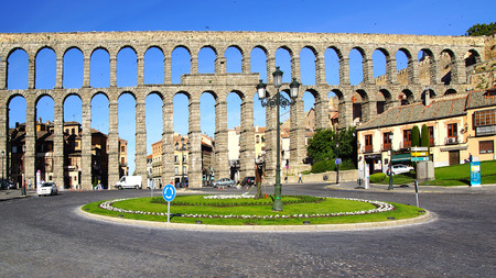 segovia: SEGOVIA, SPAIN - JUNE 09, 2014: The Roman aqueduct. The Aqueduct of Segovia was built during the second half of the 1st century A.D. under the rule of the Roman Empire and supplied water from the Frio River to the city into the 20th century.