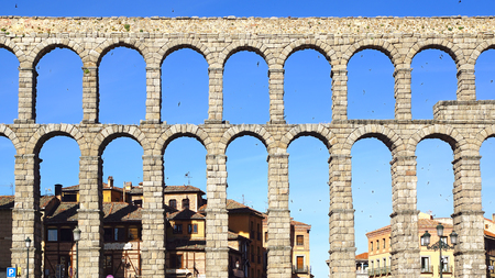 1st century: SEGOVIA, SPAIN - JUNE 09, 2014: The Roman aqueduct. The Aqueduct of Segovia was built during the second half of the 1st century A.D. under the rule of the Roman Empire and supplied water from the Frio River to the city into the 20th century.