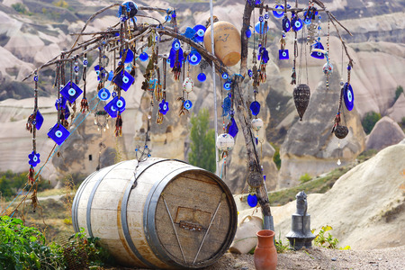 Picturesque landscape with evil eye on a tree, Cappadocia in Turkey.