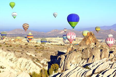 Hot air balloon flying over Cappadocia in Turkey.