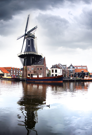 holland landscape: Picturesque landscape with the windmill. Haarlem, Holland Stock Photo