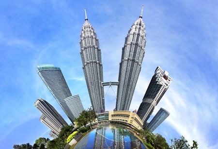KUALA LUMPUR, MALAYSIA - FEBRUARY 01, 2014: Petronas Towers. Petronas Towers, also known as Menara Petronas is the tallest buildings in the world from 1998 to 2004.