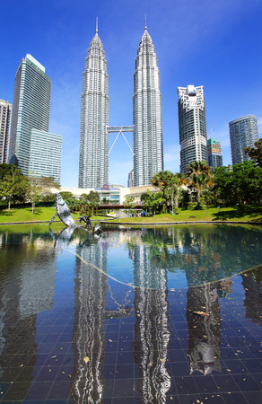 marx: KUALA LUMPUR, MALAYSIA - JANUARY 31, 2014: Park with fountains at Petronas towers. A green and quiet oasis in the city centre. Designed by the brazilian landscape artist, the late Roberto Burle Marx. Editorial