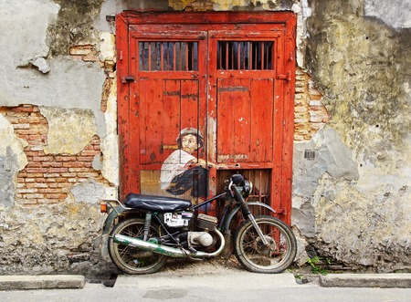 art door: Boy on a Bike Mural in Georgetown, Malaysia Editorial