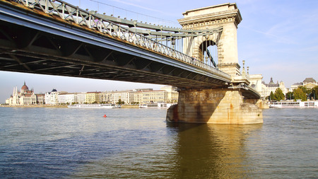 buda: Chain Bridge  is a suspension bridge that spans the River Danube between Buda and Pest. Hungary