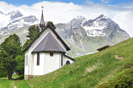 church bells: The beautiful mountain landscape with Riffelalp Kapelle. Switzerland. Stock Photo
