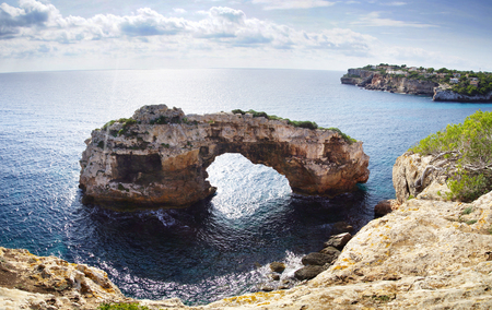 Natural arch. Es Pontas in Cala Santanyi, Mallorca, Spain.