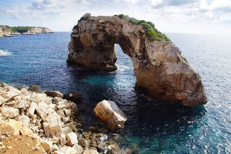 lagoon: Picturesque sea landscape with natural arch in Cala Santanyi. Stock Photo