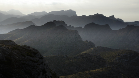 mist: Silhouette mountains under mist in the evening.