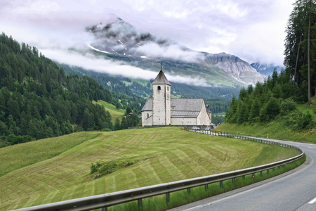 church bells: The beautiful mountain landscape with church. Switzerland. Stock Photo