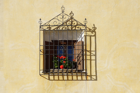 balcony: The ancient traditional window in historic medieval old town. The Zuoz today is one of the best preserved villages of the Upper Engadin.