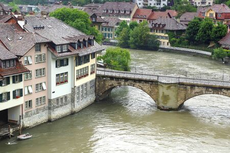 unesco world cultural heritage: BERN, SWITZERLAND - JUNE 15, 2015: Berns old town from Nydeggbruecke. Berns quaint Old Town, a UNESCO World Cultural Heritage Site, is framed by the Aare river and offers spectacular views of the Alps.
