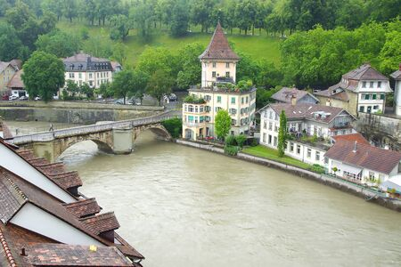 world cultural heritage: BERN, SWITZERLAND - JUNE 15, 2015: Berns old town from Nydeggbruecke. Berns quaint Old Town, a UNESCO World Cultural Heritage Site, is framed by the Aare river and offers spectacular views of the Alps.
