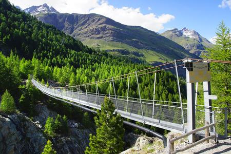 rope bridge: The mountain landscape with suspension bridge. Switzerland