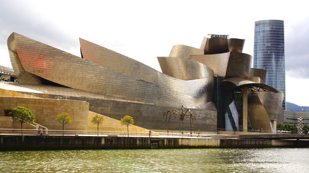 titanium: BILBAO, SPAIN - MAY 30, 2014: The Guggenheim Museum Bilbao. It is a museum of modern and contemporary art, designed by Canadian-American architect Frank Gehry. The museum is clad in glass, titanium and limestone. Editorial