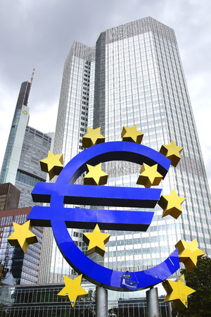 wallstreet: FRANKFURT AM MAIN- SEPTEMBER 25, 2012: The Famous Big Euro Sign at the European Central Bank. The bank was established by the Treaty of Amsterdam in 1998.