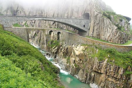 singularity: The railroad bridge Teufelsbruecke - Devils bridge.The Schollenen Gorge is an important route and the shortest transit to the St. Gotthard Pass Stock Photo