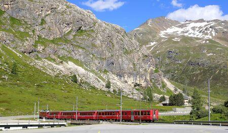 aletsch: Train at Bernina Diavolezza station on the Bernina Railway line. It is located at the foot of the Diavolezza mountain as well as near the Diavolezza ski regions. Stock Photo