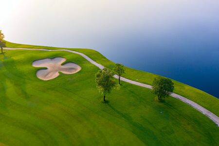 Aerial view of golf field landscape with sunrise view in the morning shot. Bangkok Thailand