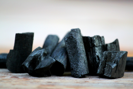 Charcoal. Pile of natural wood charcoal