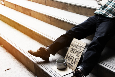 Homeless man on walkway street in the city.