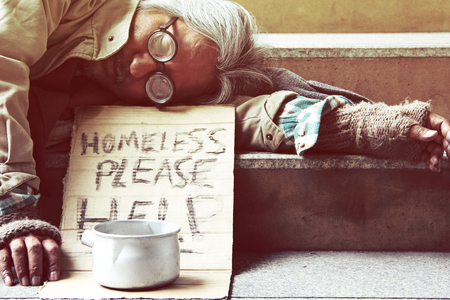 Could you please help homeless man sleeping on walkway street in the capticap city.