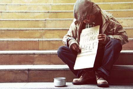 Beautiful Homeless man on walkway street, Homeless concept.