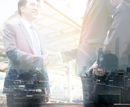 Abstract business handshake team double exposure capital city background.