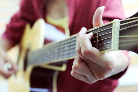 Close up women playing acoustic guitar. Reklamní fotografie